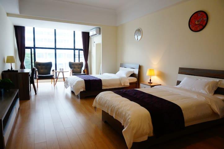 豪华园景双床房 - Qingdao - Lägenhet