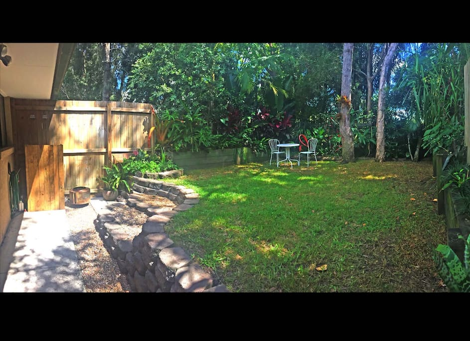 Private tropical garden at the back, there's a fire tub and fire wood provided.