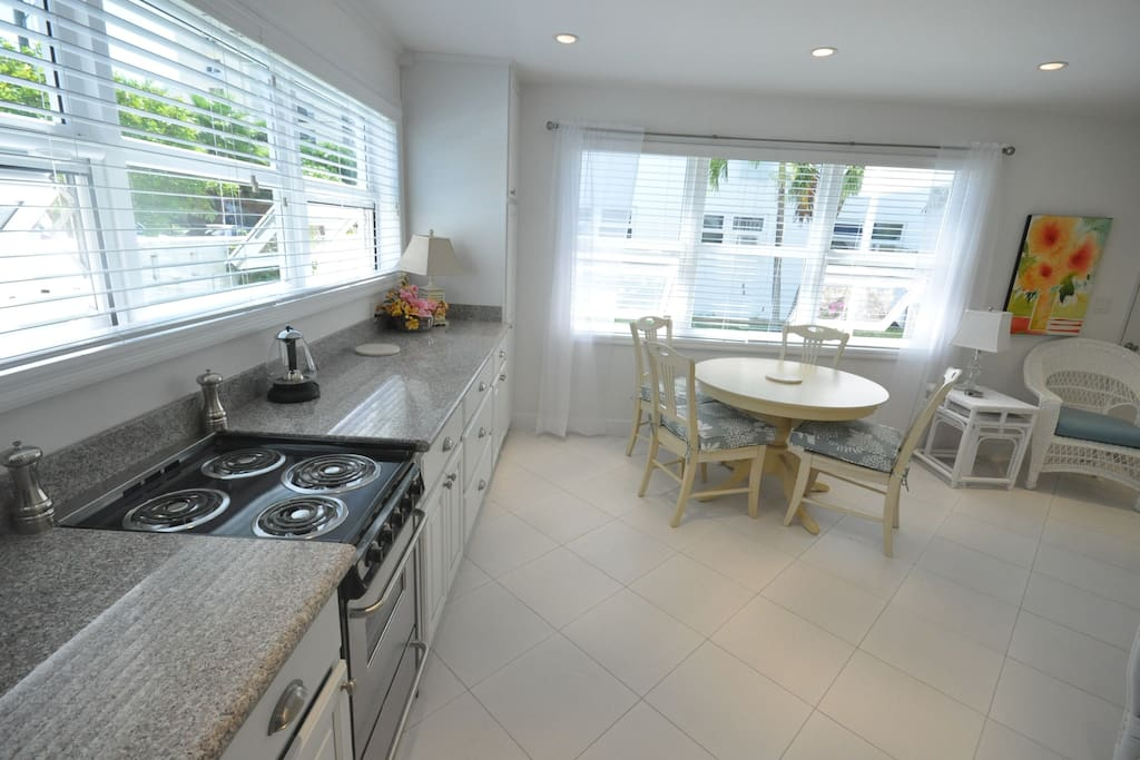 Villa 9 has a fully equipped kitchen and a bright, comfortable dining area.