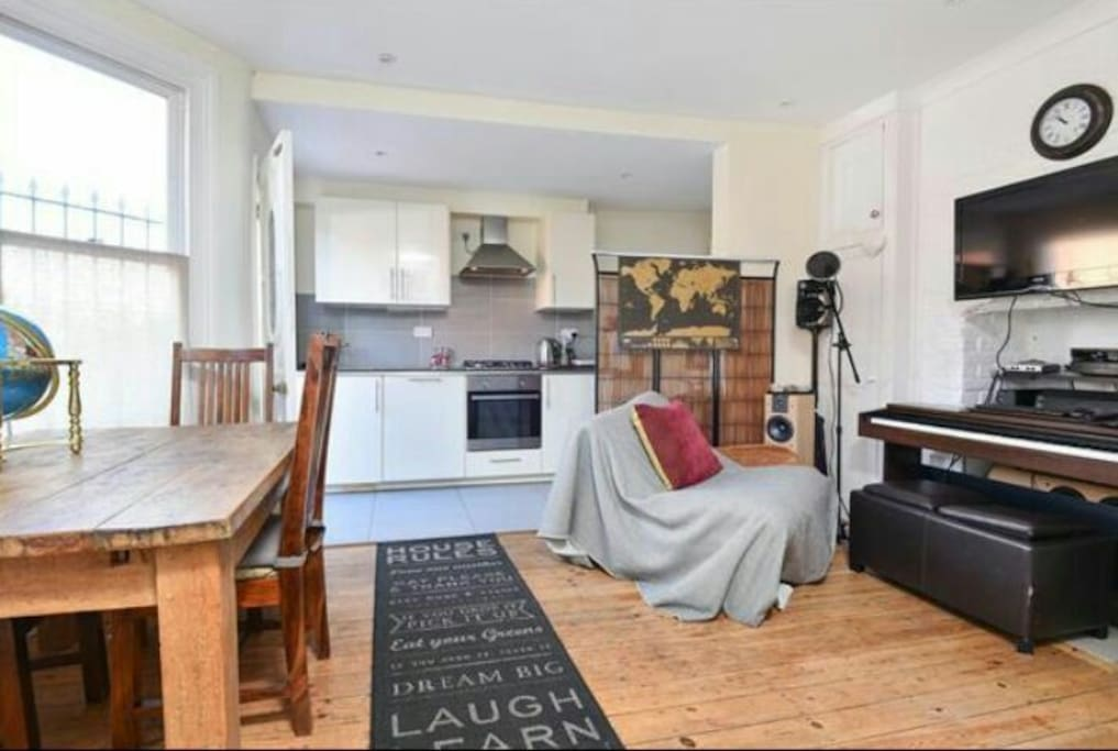 "open plan kitchen/laundry room hidden behind kithen +wireless pc & music studio with piano +32""screen"