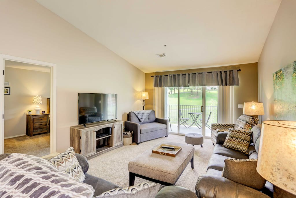 The home boasts a comfortable, open-concept living space filled with natural light flooding from patio doors.