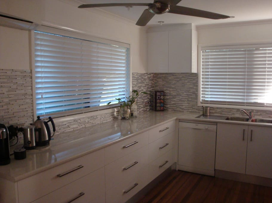 Executive kitchen with all the mod cons, pod coffee maker, dishwasher.