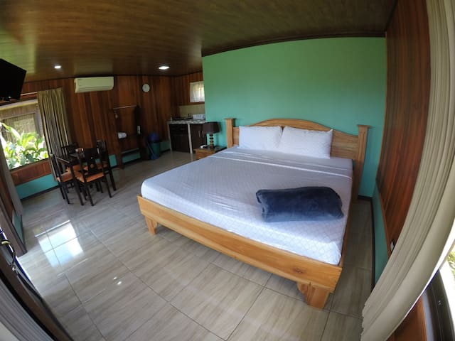 Comfortable bedroom with A/C, kitchen and private bathroom with hot water