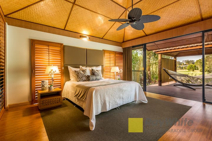 Master bedroom is situated downstairs and has hammock adjoining in Bali Hut.