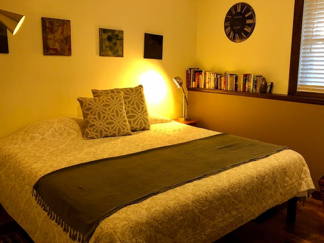 This is the larger of the two bedrooms with a king size bed. There is a medium size closet to the far right back corner of the room not visible in this photo.