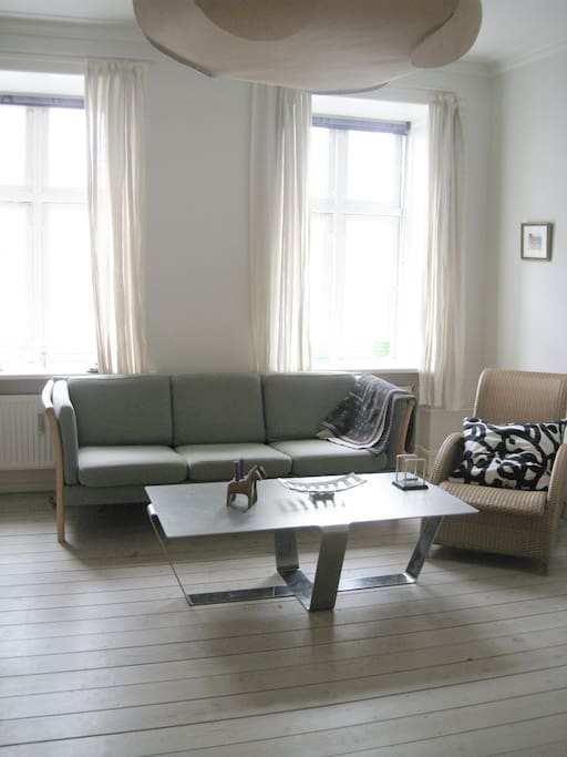 Living room with a sofa for 3 persons, which you can also sleep on.