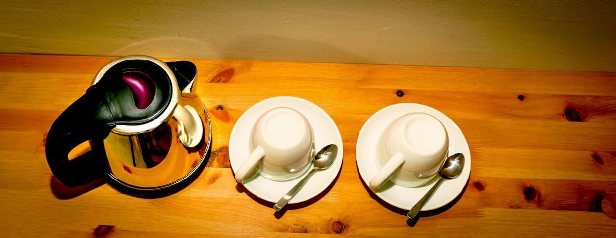 An electric kettle, cups, saucers and teaspoons provided in all rooms