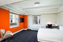 Your window into Times Square, downtown cool – yet sophisticated hotel rooms in New York.