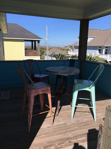 The back porch is perfect for morning coffee or a night cap.