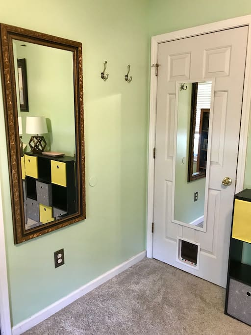 Antique mirror and sturdy hooks for your convenience.