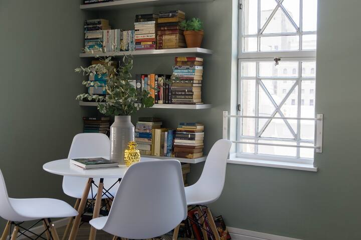 The breakfast nook doubles as a reading corner on sunny afternoons