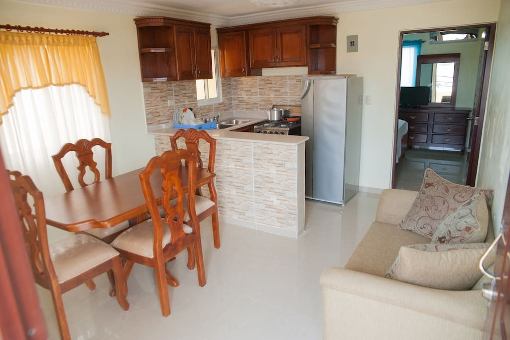 Fully furnished dining and seating areas includes equipped kitchen and kitchenware