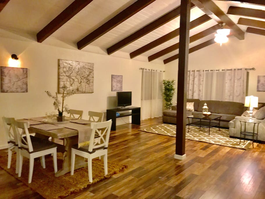 The Open Living and Dining Area with Beautiful Exposed Beams