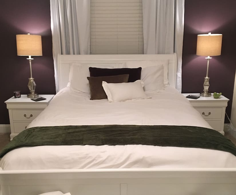 The queen size bed with dual nightstands provides comfort and access to plugs for charging electronic devices while you rest.