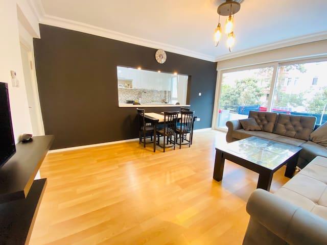 Living room + bar and view into the kitchen/ Wohnzimmer mit Aussicht in die Küche