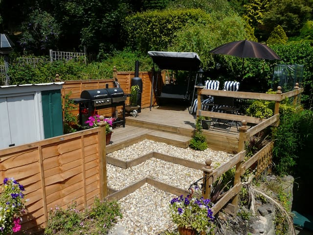 Garden with duel BBQ, log burner and seating