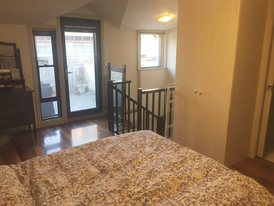 master bedroom with ensuite and access to roof terrace