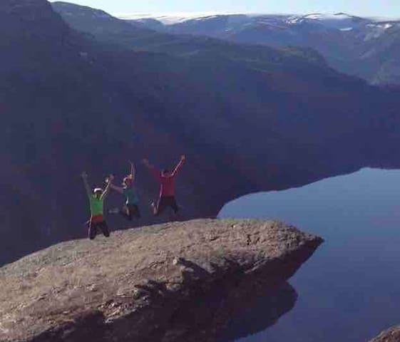Trolltunga - 2 hour drive to the place where the hiking starts. Two friends and me jumping - it's magic!