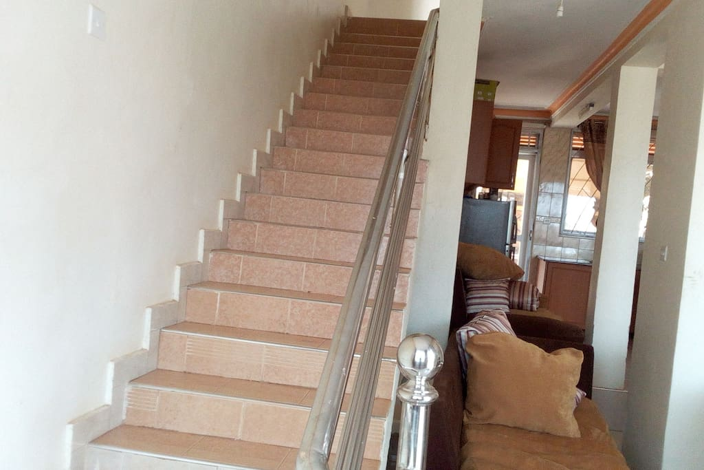 Stairs going up to the bedrooms.
