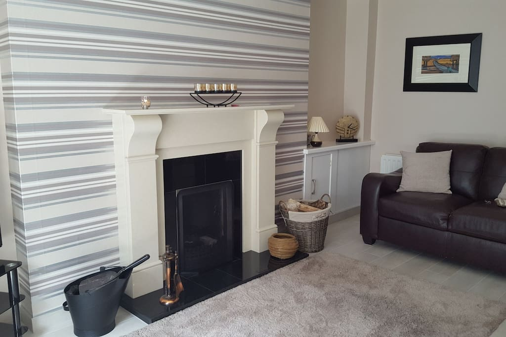 Main lounge with open fire or oil central heating.