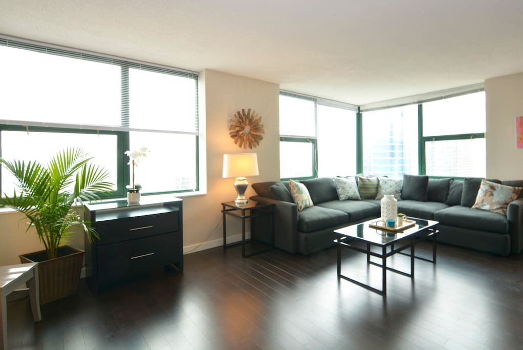 Comfortable and stylish living room with plenty of seating and amazing views.