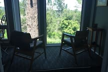 Outer room sitting area with view of forest
