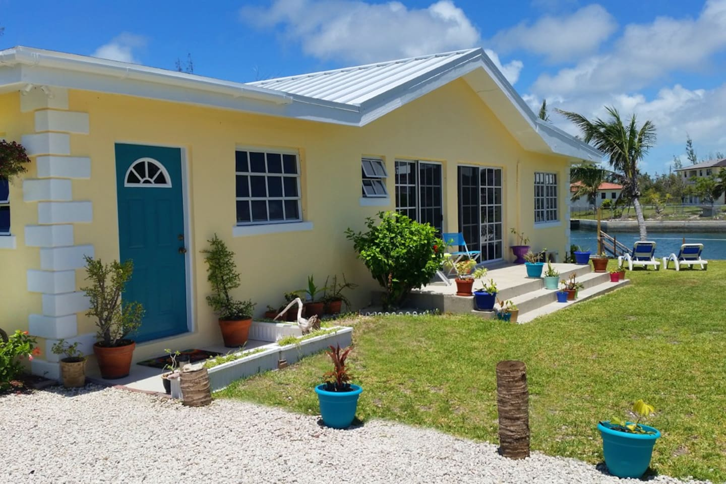 The villa is across from the beach and located on an inland waterway