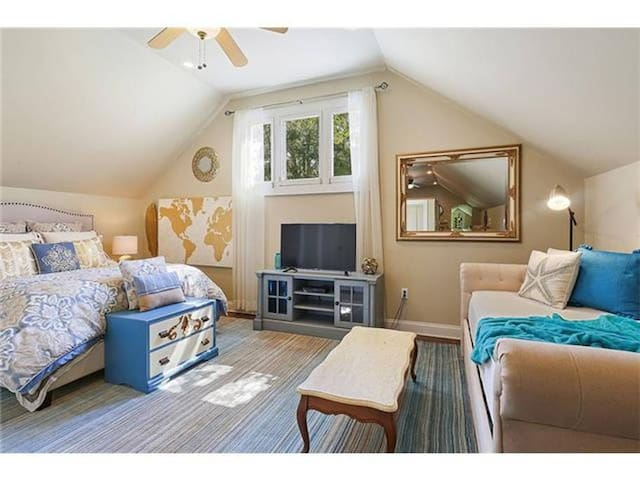 The bedroom features a queen bed, as well as a twin daybed with trundle. (Since this photo was taken, we have added black out curtains to the windows...so you can cuddle up in the fluffy down comforter as long as you like!