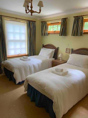 Twin ground floor bedroom with en-suite shower room.