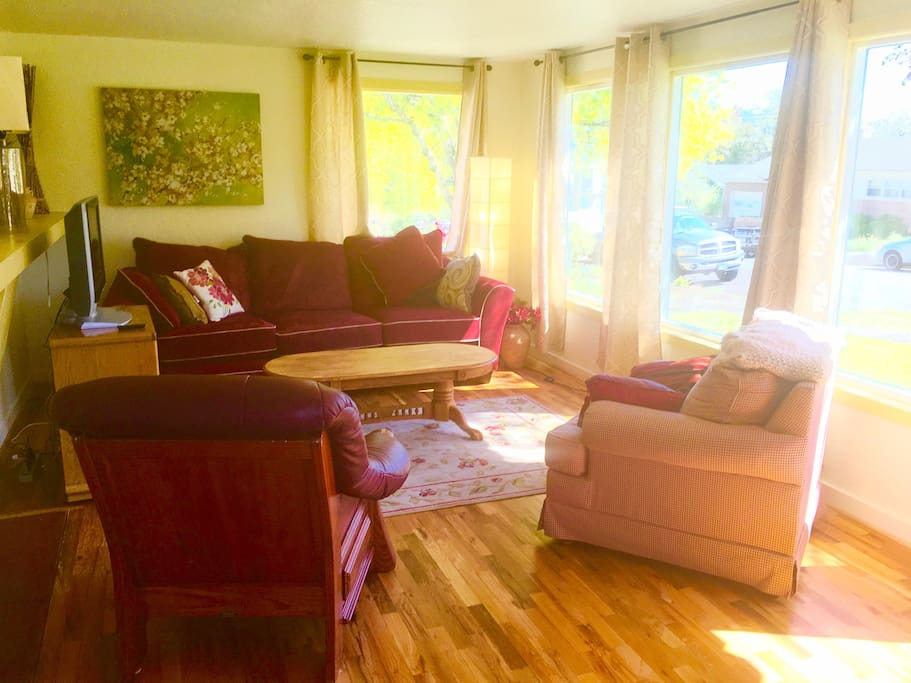 New drapes and newly refinished hardwood floors put in the living room!