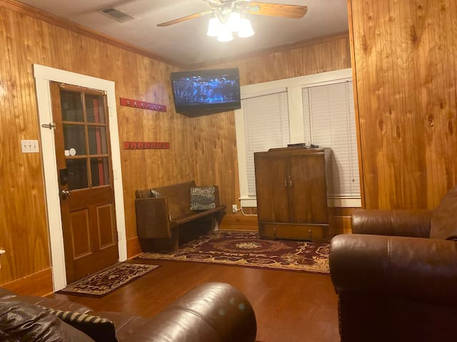 Panoramic view of the multipurpose room (2nd living room) with the antique Murphy bed in the window