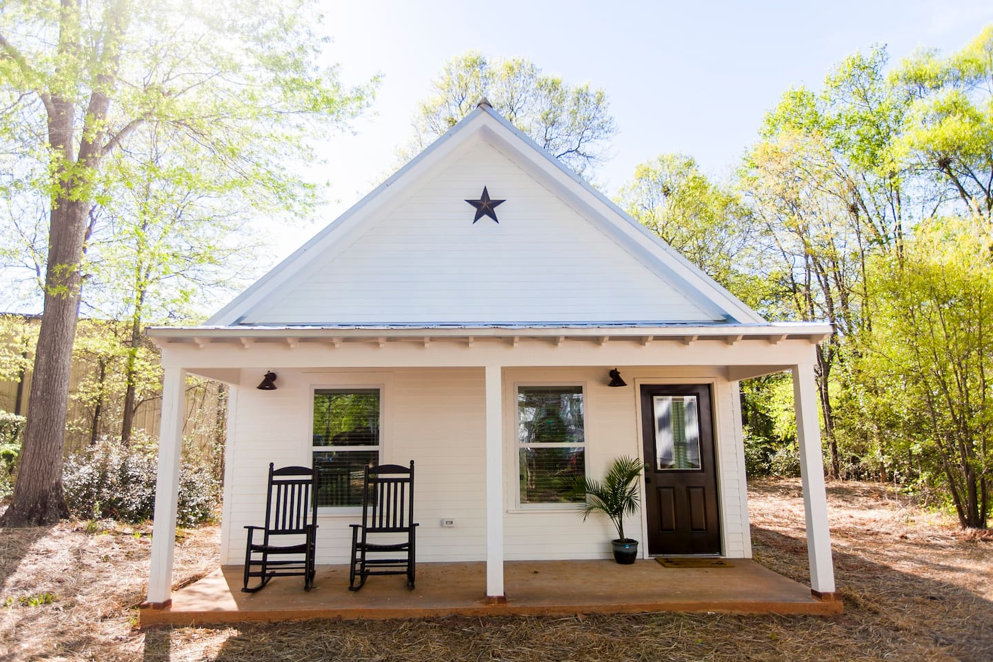 Our 1BR/1BA guest cottage is tucked away on the far side of our 1 acre lot - the entrance is private and completely separate from our main residence. Enjoy the rocking chair front porch!