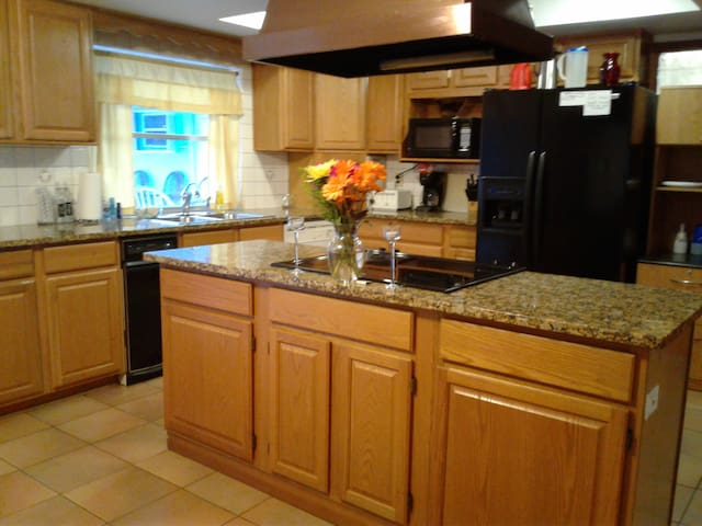 Kitchen with top of the line appliances and everything to have at home meals.