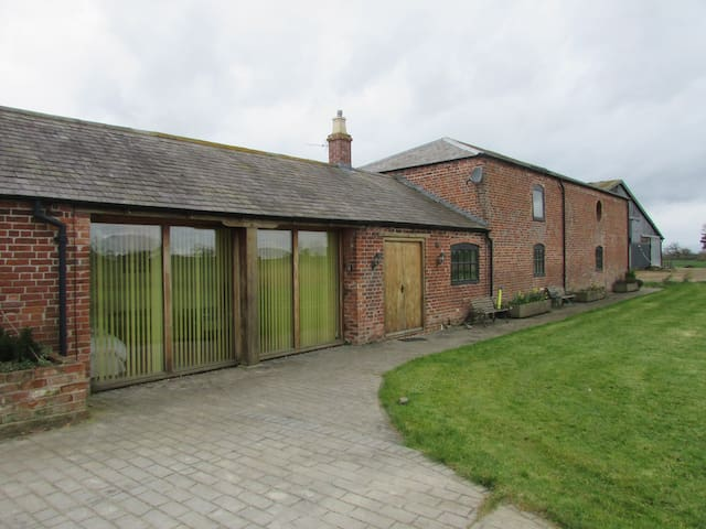 The Barn at Kenwick Lodge Farm sleeps 12, 22 or 30