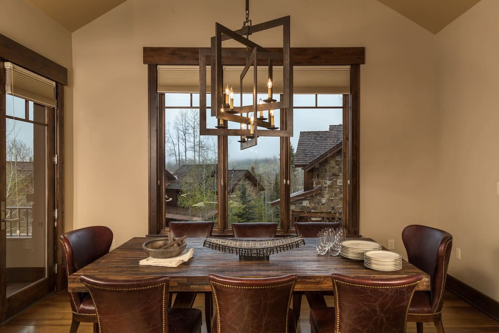 Huge views from the dining area with formal seating for 8 and additional seating at the kitchen bar
