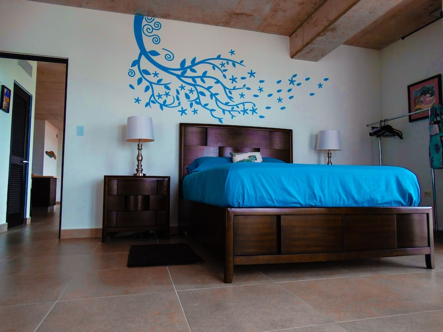 Beautiful bed room with glass walls looking to old San Juan