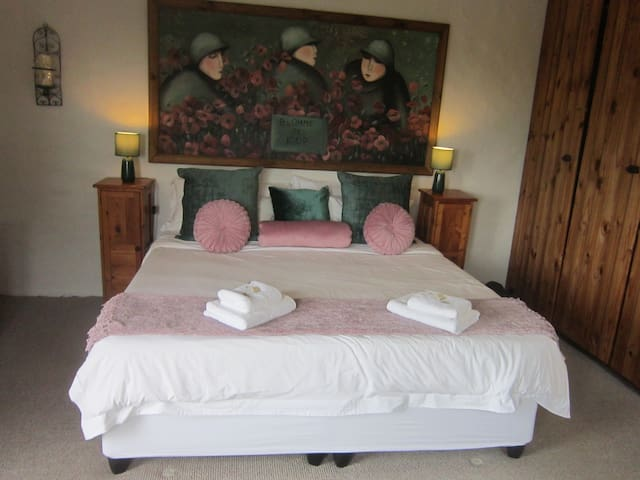 Spacious room with extra length King size bed. Small balcony with distant sea view.