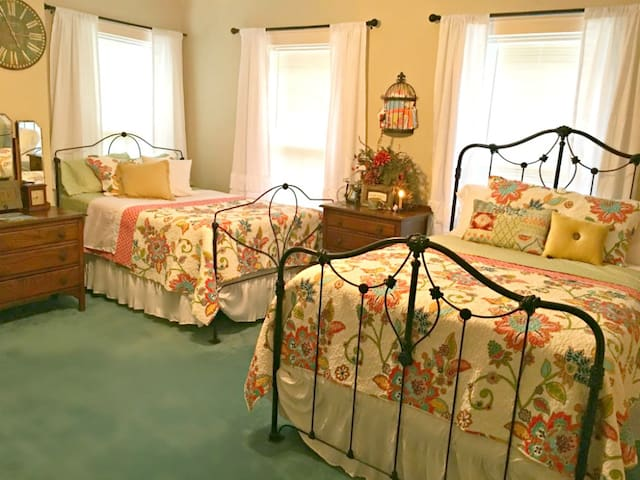 The Twin Estate Room is spacious and has 2 double antique iron beds. Room enough for 4.