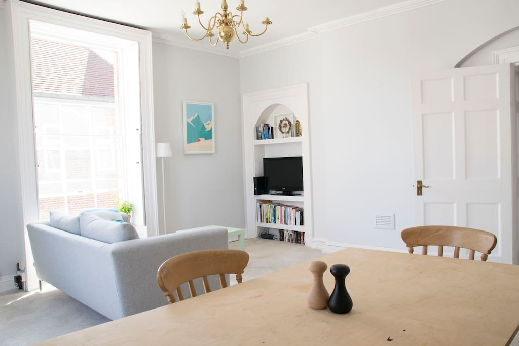 Our lovely light and airy living room with dining table