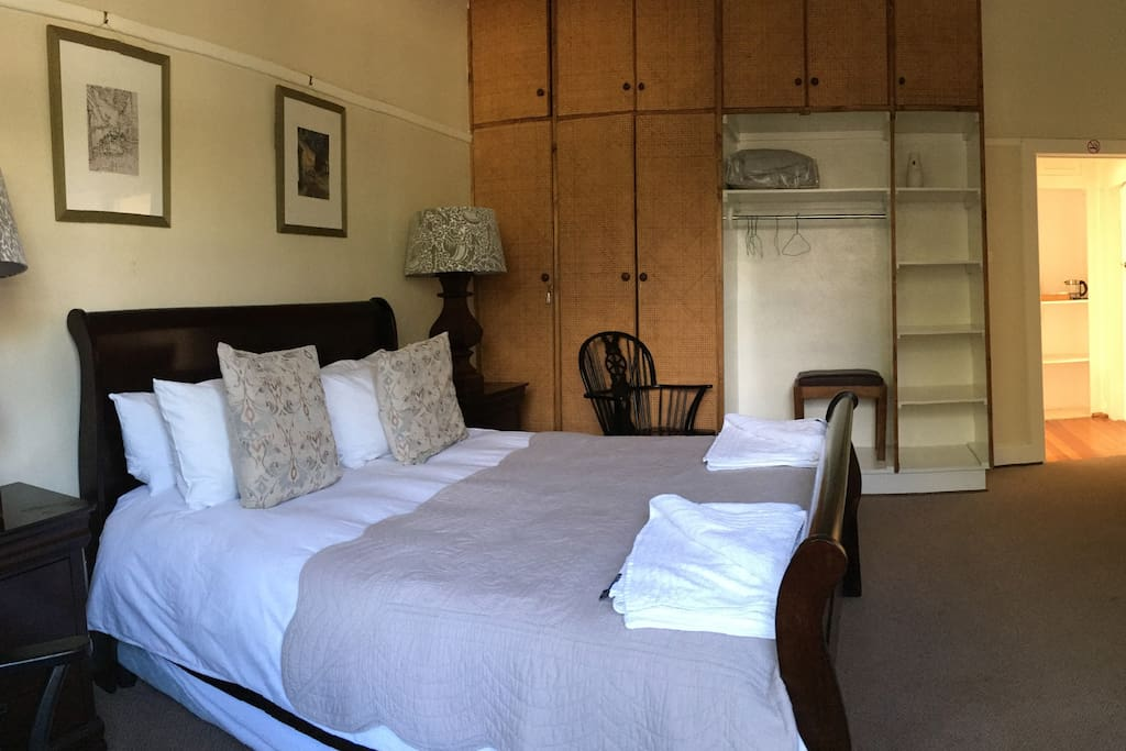 Bateleur guest room has Queen and single bed with ensuite (bath with shower over)