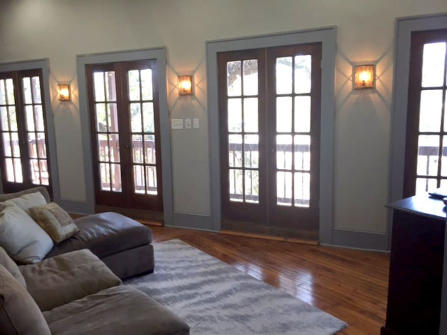 The 4 sets of French doors leading to the private balcony.