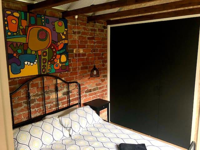 Queen bedroom with built-in wardrobe