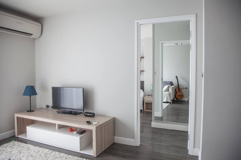 Tv space and door way to the bedroom