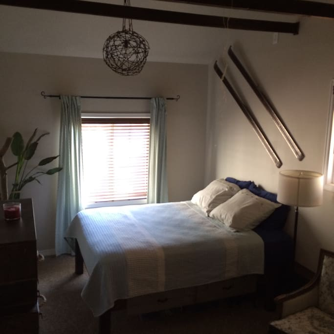The master bedroom is spacious and cozy with an attached private bathroom.