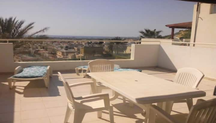 Bright flat with large patio and full seaviews