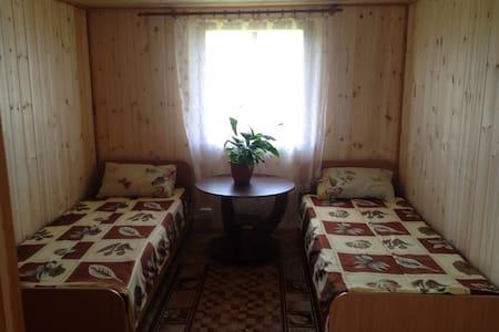 Кровать в общей комнате . - Хужир