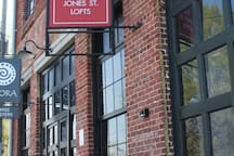 Outside of building...look for coffee shop and red sign.
