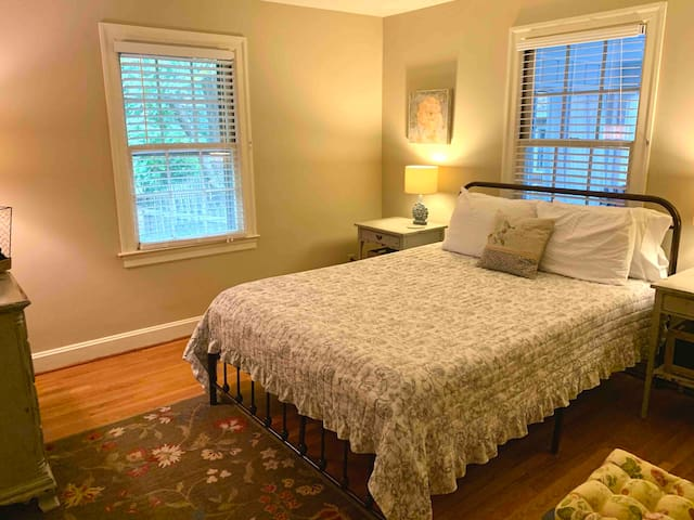 This bedroom features a queen bed with a comfy mattress and clean, comfy sheets and blankets. It shares the hall bathroom with one other bedroom.