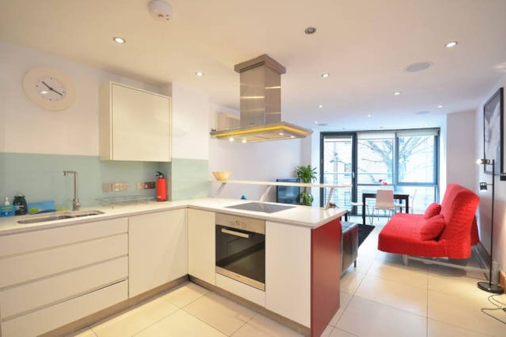Open plan kitchen with a sofa bed for two people . Kitchen fully equipped  for 4 people