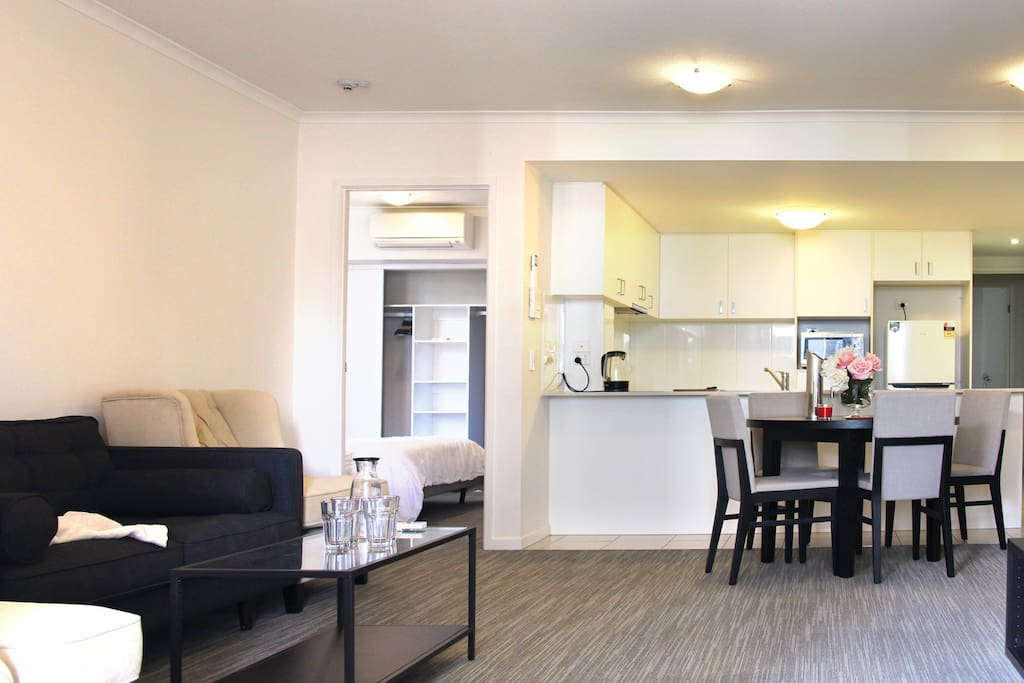 Open and spacious living & dining area with a private bedroom.